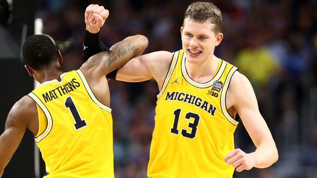 Michigan Basketball celebrates their drawing into the 2018 National Championship where they will face Villanova